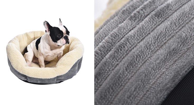 AmazonBasics - Cama para mascotas redonda y cálida